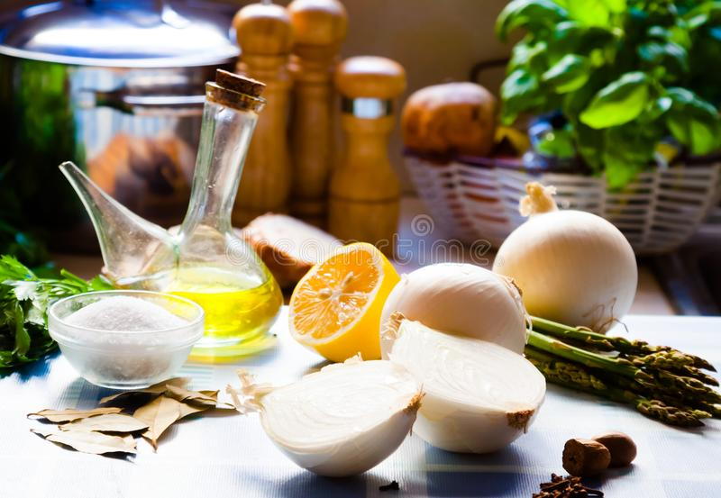 Salt, olive oil, onion, asparagus on a table. Image Salt, olive oil, onion, asparagus on a table royalty free stock images