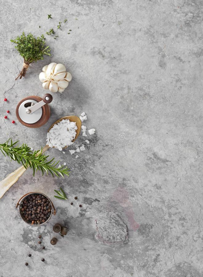 Salt, pepper, garlic and herbs stock photography