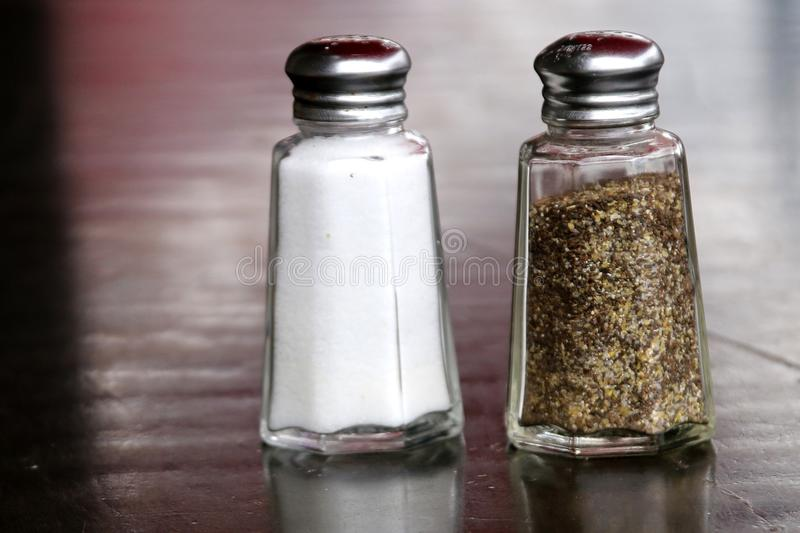 Salt and pepper shakers go together. stock photos