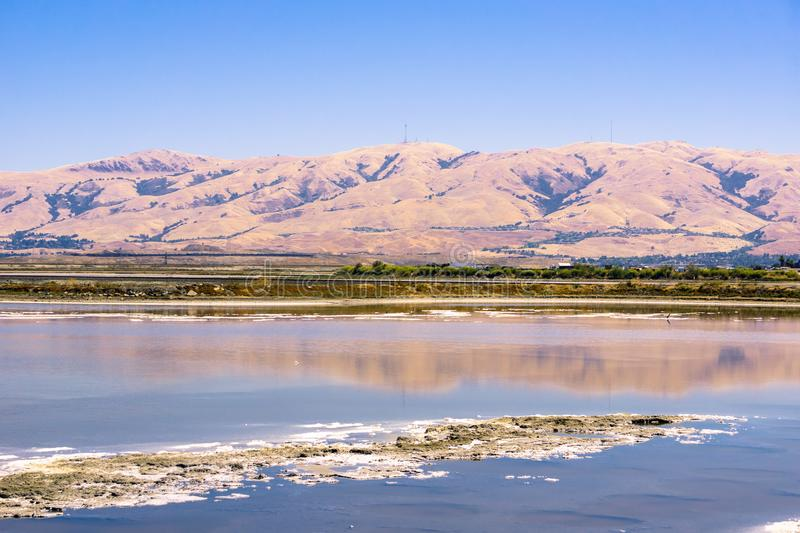 Salt ponds at Alviso Marina County Park. Mission Peak and Monument Peak in the background, San Jose, south San Francisco bay, California stock photography