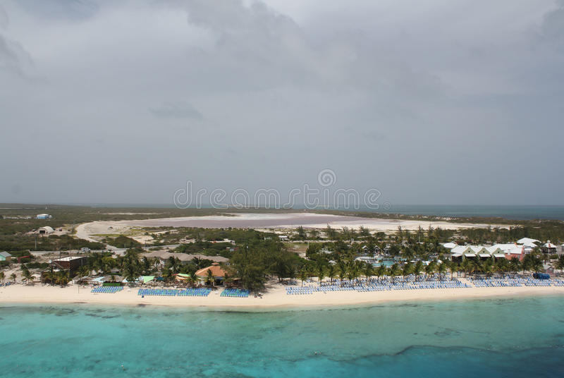 Salt ponds at Grand Turk & Caicos. Salt ponds can be seen in the background as a ship enters the port at the island of Grand Turk & Caicos in the Caribbean royalty free stock image