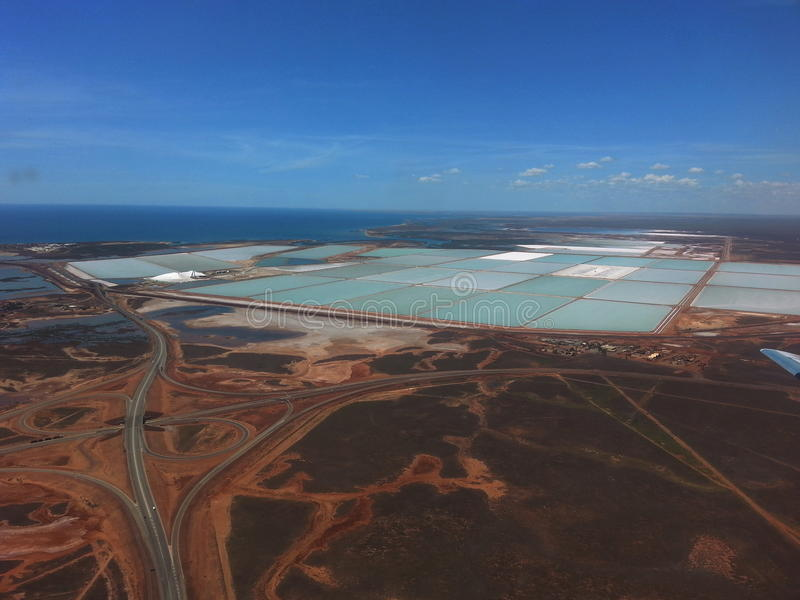 Salt production ponds Port Hedland Western Australia. Aerial view of evaporative salt ponds in Port Hedland Western Australia Sodium Chloride. They fill with sea royalty free stock photography