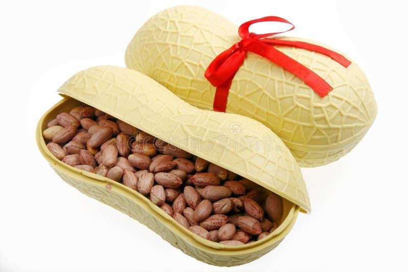 Salt-roasted peanuts. In peanut shape gift box royalty free stock photos