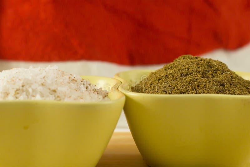 Salt sea large granules ground coriander brown powder seasoning in green ceramic bowls macro design stock image