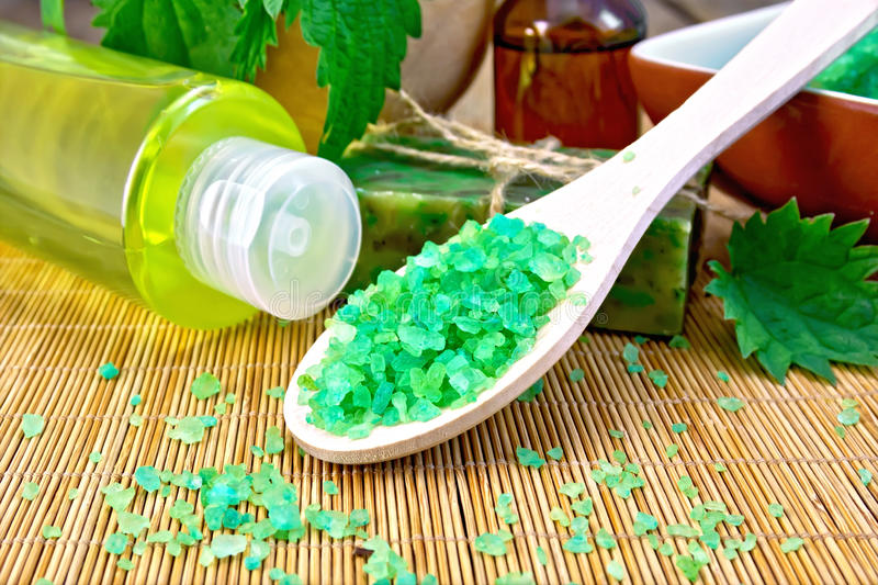 Salt and toiletries with nettles on board stock images