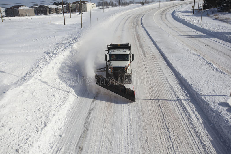 Snow Plow head on. A snow plow clears snow on a highway that bypasses Charlottetown stock photos