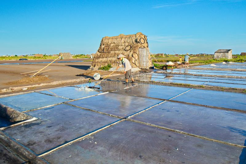 Salt workers working on salt fields. This location used to be the largest salt production site in Northern Vietnam but now almost stock photos