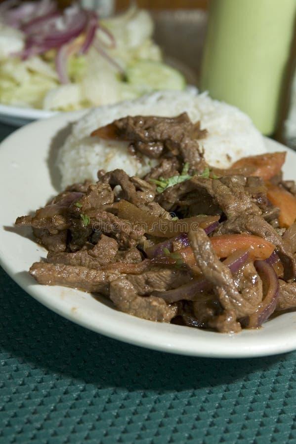 Saltado Peruviaans lapje vlees van Lomo royalty-vrije stock afbeeldingen