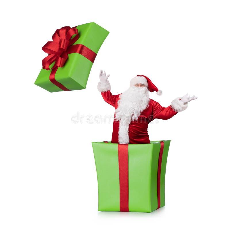 Saltar de Samta Claus da caixa de Natal fotos de stock royalty free