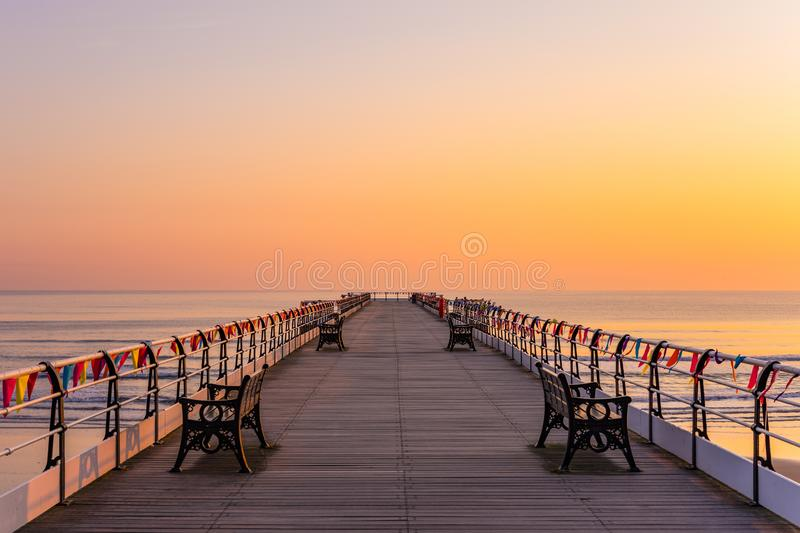 Saltburn pier and a golden sunrise. North Yorkshire. royalty free stock image