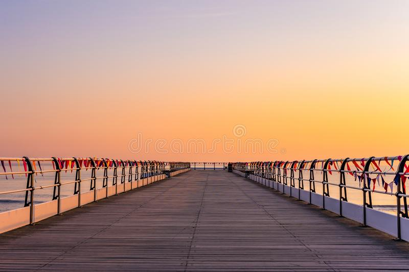 Saltburn pier and a golden sunrise. North Yorkshire. stock images