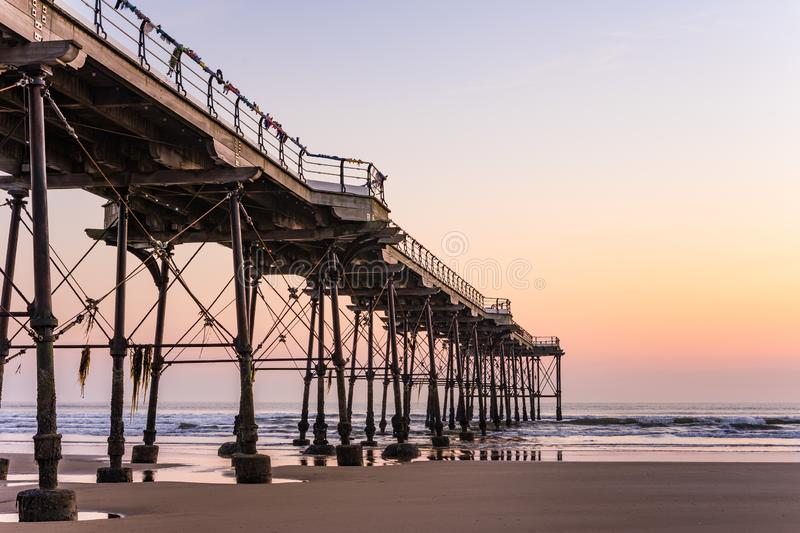 Saltburn pier and a golden sunrise. North Yorkshire. royalty free stock photo