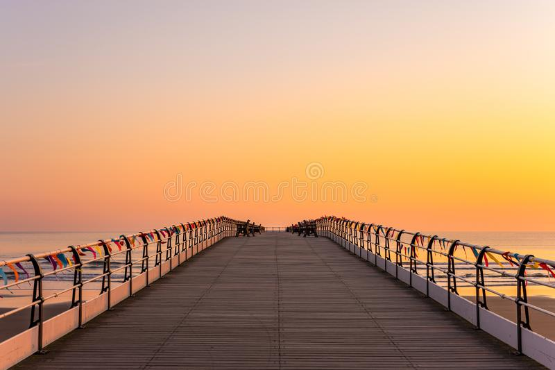 Saltburn pier and a golden sunrise. North Yorkshire. royalty free stock photos