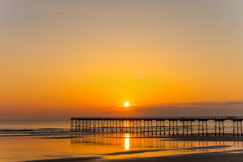 Saltburn pier and a golden sunrise. North Yorkshire. stock image