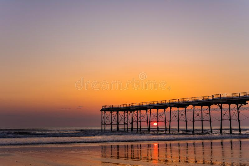 Saltburn pier and a golden sunrise. North Yorkshire. royalty free stock photography