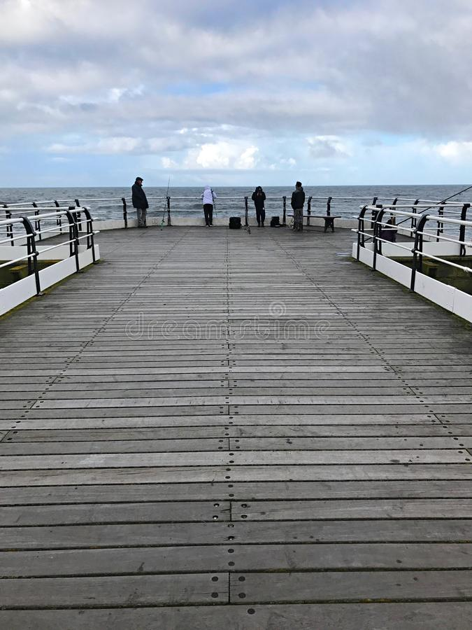 Fishing from the Pier at Saltburn by the Sea royalty free stock images