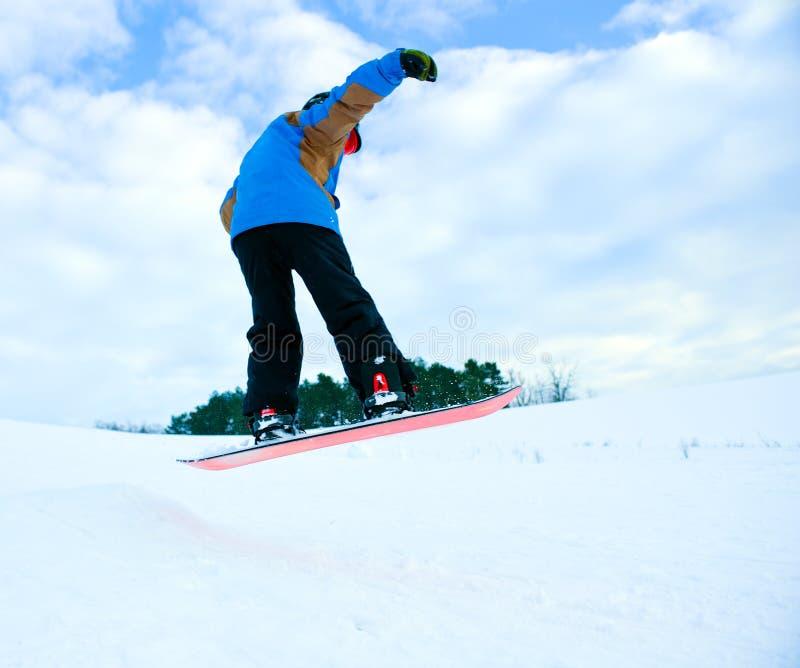 Salte con la snowboard imagen de archivo