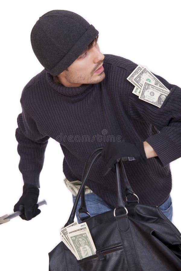 Salteador de banco que funciona com dinheiro foto de stock