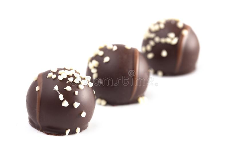 Salted Caramel Filled Dark Chocolate Truffles on a White Background. Salted Caramel Filled Dark Chocolate Truffles Isolated on a White Background stock photos