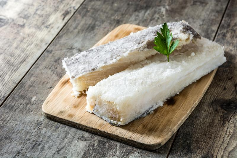 Salted dried cod on wood. Typical Easter food. Salted dried cod on wooden table. Typical Easter food stock images