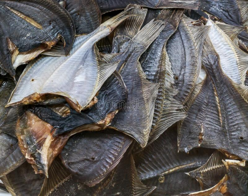 Salted dried fish on the market shelf stock photography