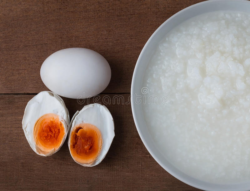 Salted egg and gruel royalty free stock photos