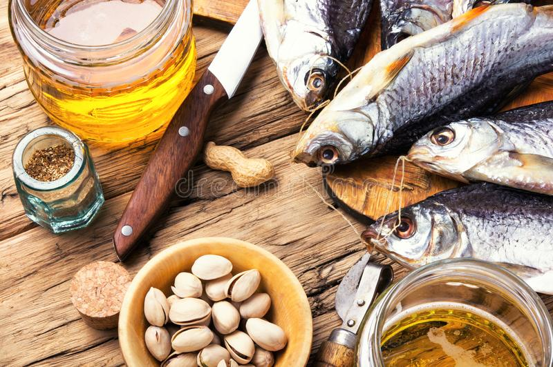 Salted fish and beer stock photos