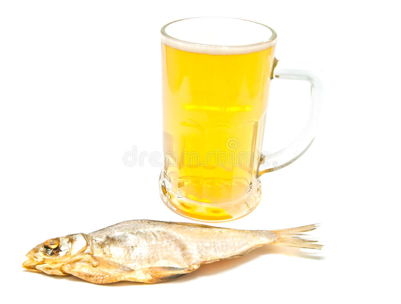 Salted fish and glass of beer. On white royalty free stock image