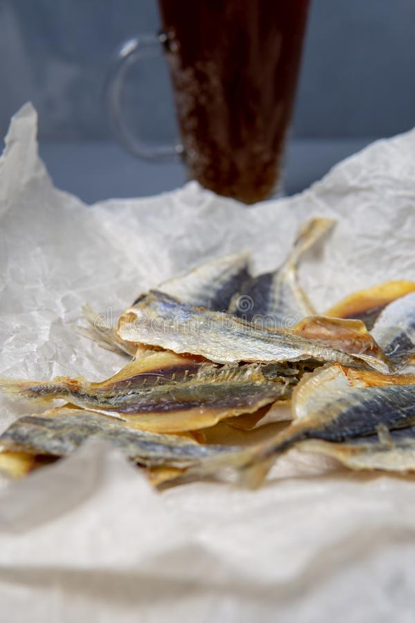 Salted fish lies in unfolded paper stock image