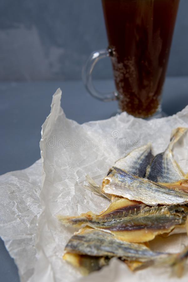 Salted fish lies in unfolded paper stock images