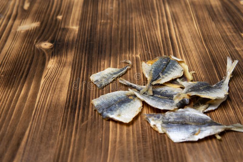Salted fish lying on a wooden table stock image