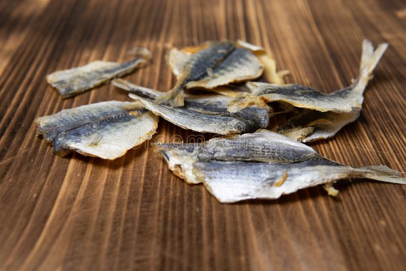 Salted fish lying on a wooden table royalty free stock photos