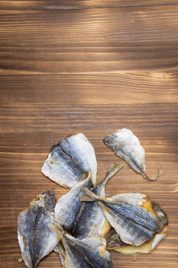 Salted fish lying on a wooden table stock photos