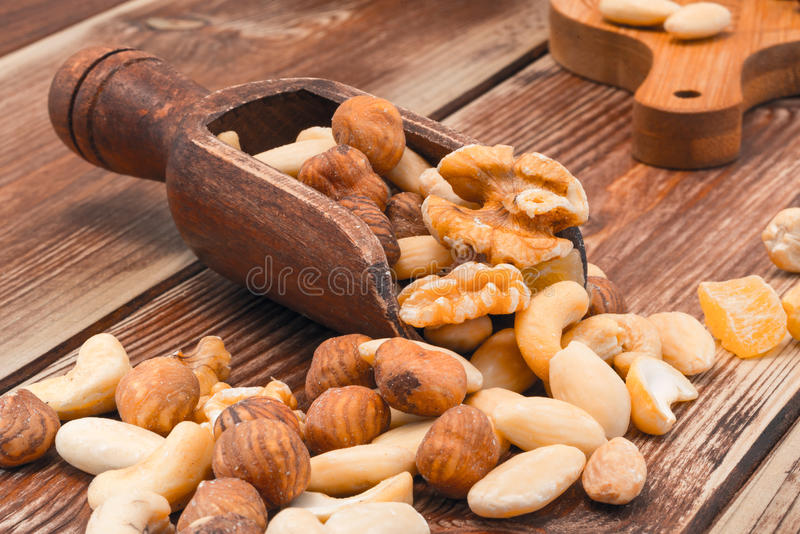 Salted nuts on wooden table. Coffee beans, cup of coffee, coffee beans on the wooden table stock photos