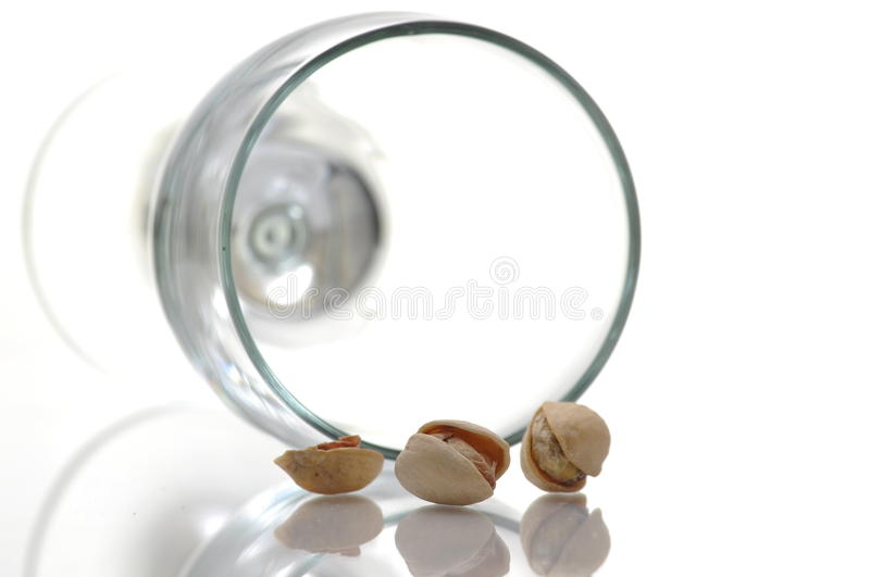 Salted Pistachio And Glass Stock Photo