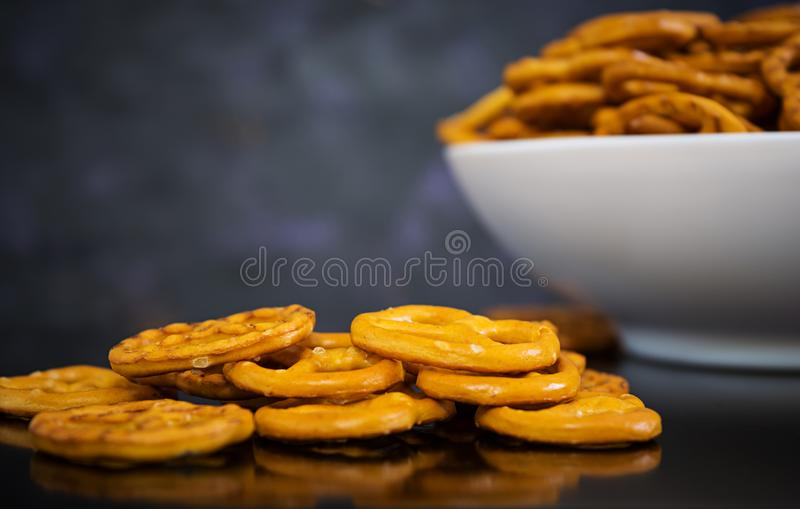 Salted pretzel on dark background.  royalty free stock photos