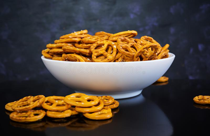 Salted pretzel on dark background.  stock photo