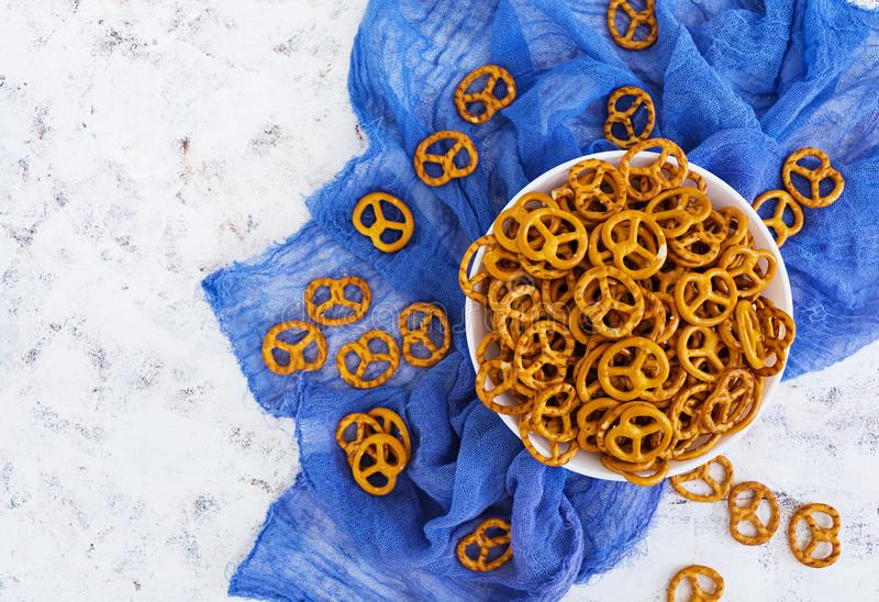 Salted pretzel on white background.  stock images