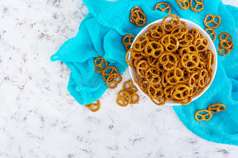 Salted pretzel on white background.  royalty free stock photography