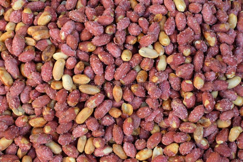 Salted roasted peanuts with red peel stock image