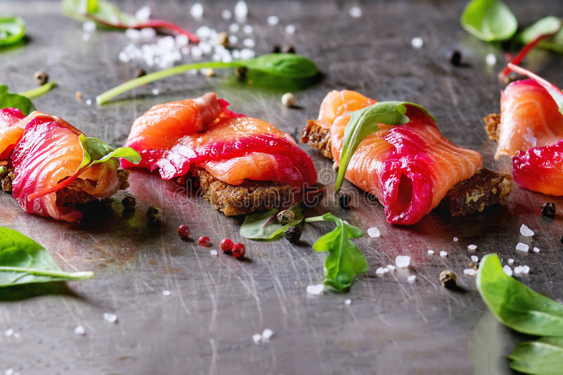 Salted salmon with beetroot stock photos