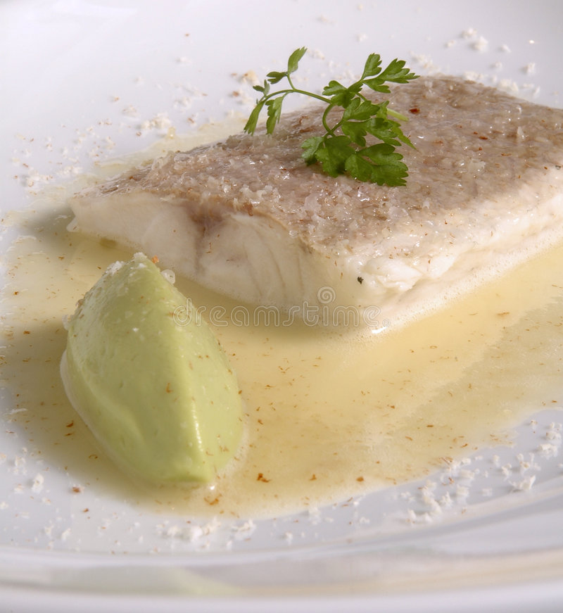 Salted Sea Bass. In a butter cream sauce royalty free stock photography