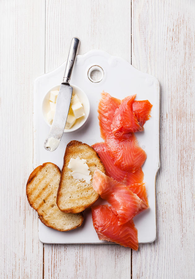 Salted smoked red fish and slices of bread royalty free stock photo