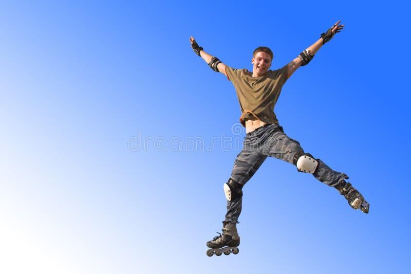 Salto activo del muchacho del rodillo foto de archivo libre de regalías