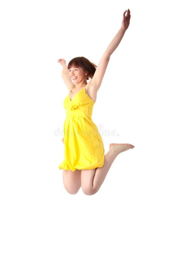 Salto adolescente de sorriso da menina dos jovens imagem de stock royalty free