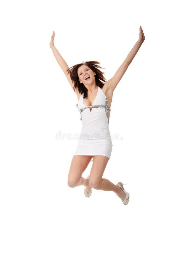 Salto adolescente sonriente de la muchacha de los jóvenes imagenes de archivo