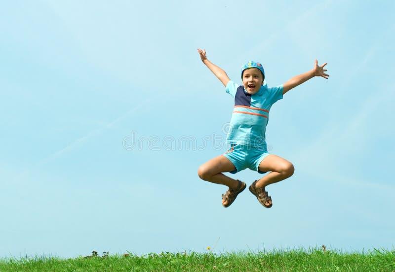 Salto alegre foto de stock