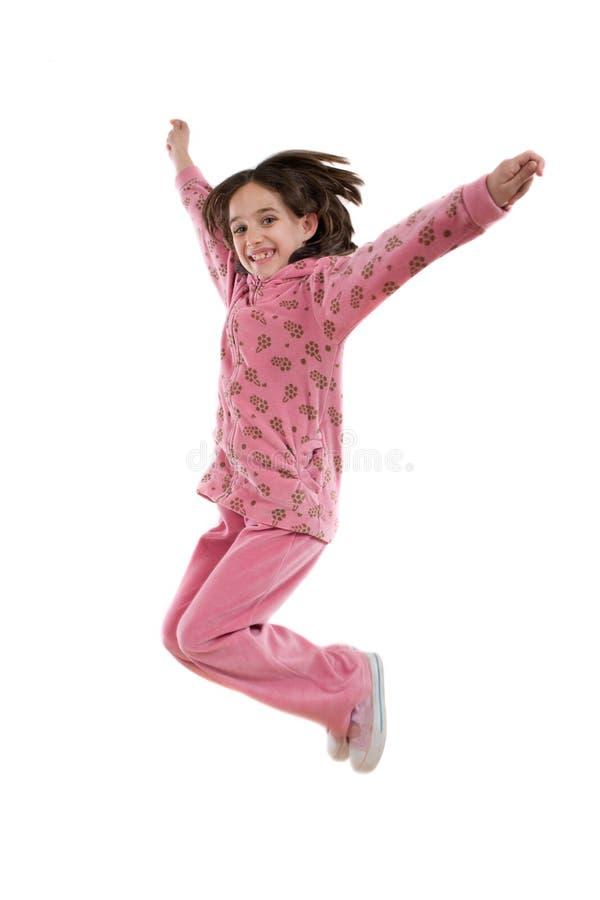 Salto alegre de la niña fotos de archivo libres de regalías