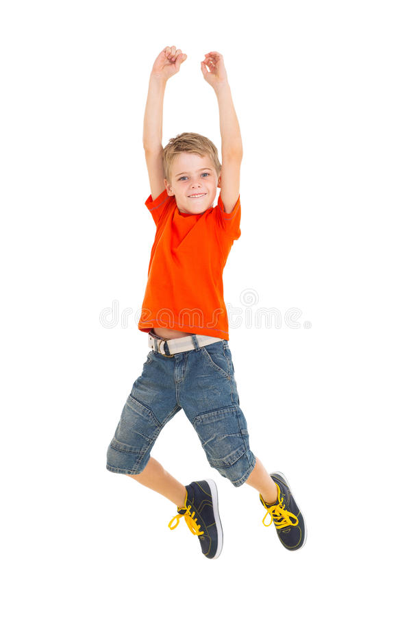 Salto alegre del muchacho fotografía de archivo libre de regalías
