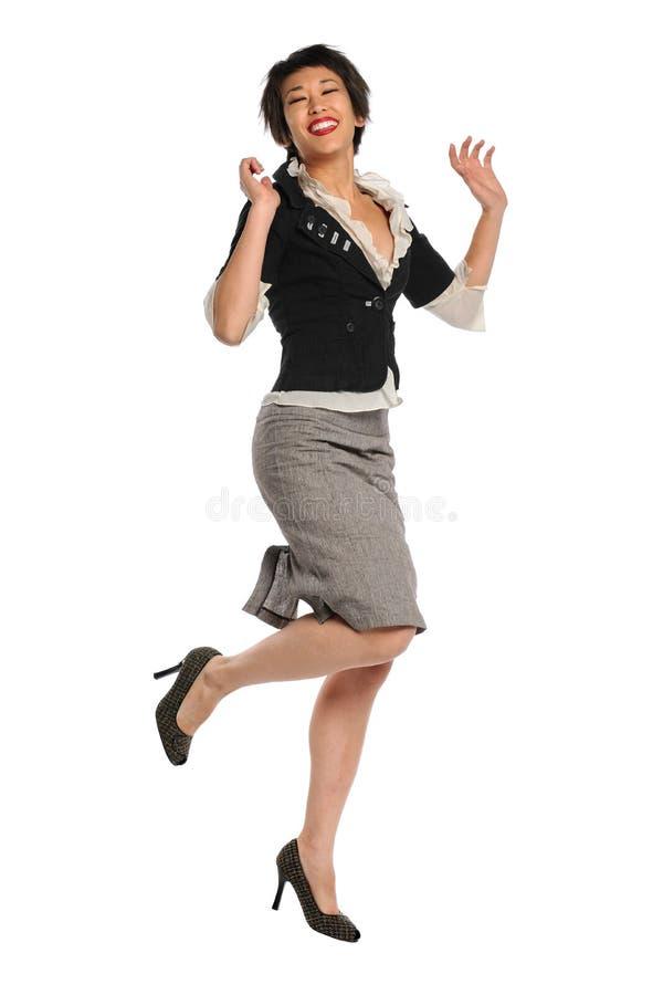 Salto asiático da mulher de negócios fotos de stock royalty free